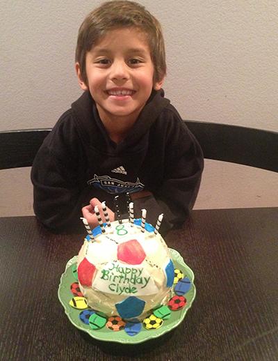 Eight years old.  Cake made by grandma.